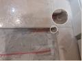 Ремонт электрического теплого пола, поврежденного при установке дверного ограничителя
